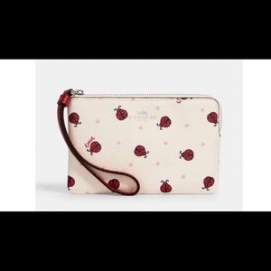 Coach Corner Zip Wristlet With Ladybug Print